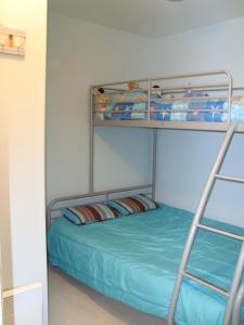 Un ou plusieurs lits superposés dans un hébergement de l'établissement Residence Les Argousiers