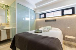 Ein Bett oder Betten in einem Zimmer der Unterkunft Monopoly Madrid