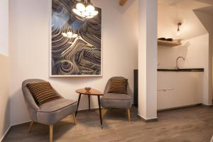 A seating area at Apartment Stube 4