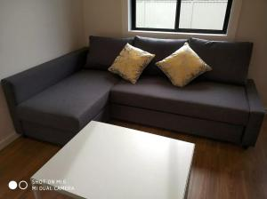 A seating area at brand new one bedroom house with Aircondition