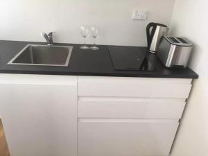 A kitchen or kitchenette at brand new one bedroom house with Aircondition
