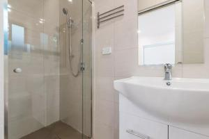 A bathroom at brand new one bedroom house with Aircondition