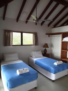 A bed or beds in a room at Turtle Bay Beach House