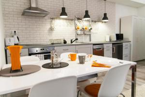 A kitchen or kitchenette at Cheery-roomy flat in a downtown walking street