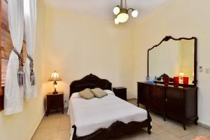 A bed or beds in a room at Casa del Sol by Kenia