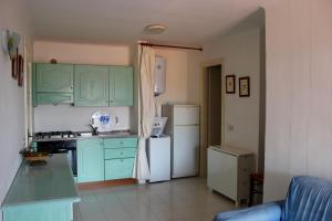 A kitchen or kitchenette at I Tramonti Apartments