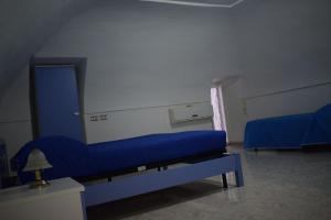 Letto o letti in una camera di Al centro di Procida