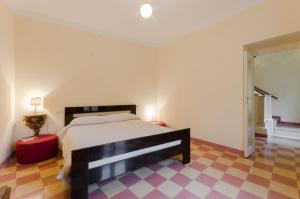A bed or beds in a room at Dimora delle Fonti