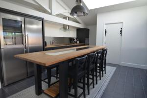 A kitchen or kitchenette at COSY NOX Bordeaux