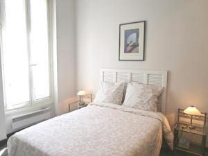 Un ou plusieurs lits dans un hébergement de l'établissement Appartement
