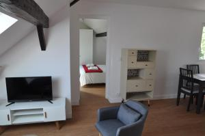 A television and/or entertainment center at RESIDENCE ROCHEGUDE-Appart n°3-NEAR LA DEFENSE/PARIS