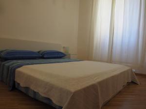 Een bed of bedden in een kamer bij Casamanthone53