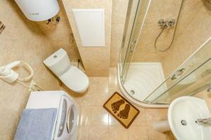 Koupelna v ubytování Apartment on 16А Obolonskyi Avenue