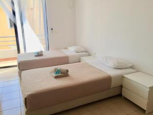 A bed or beds in a room at Sea and Sky Apartments Sarande