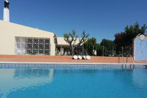 The swimming pool at or near E - Countryside Guesthouse 2 Bed Apartment