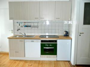 A kitchen or kitchenette at City Apartment Berlin