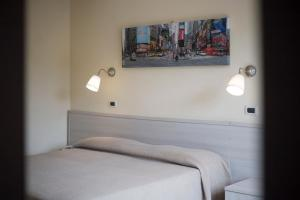A bed or beds in a room at Residence Hotel Villa Mare