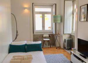 A bed or beds in a room at MimApartment Porto Charming Central