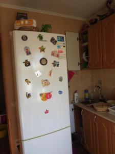 A kitchen or kitchenette at Апартаменты на Чемпионат