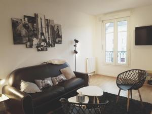 A seating area at Cosy Apartment Carré Elysée Serris