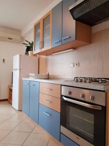 A kitchen or kitchenette at APARTMENTS LUMA 1