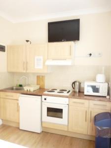 Η κουζίνα ή μικρή κουζίνα στο Earls Court Studios