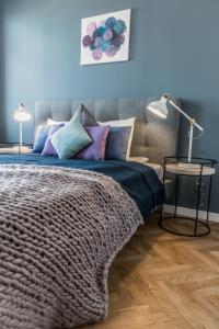 Lova arba lovos apgyvendinimo įstaigoje Greystone Suites & Apartments