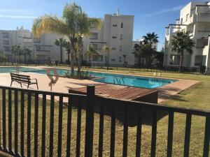 The swimming pool at or near Apartment Equipo Nacional Maraton