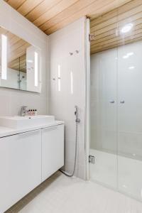 Kylpyhuone majoituspaikassa Helsinki Homes Apartments