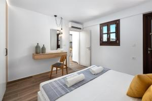 A bed or beds in a room at Lindos Heart Apartments