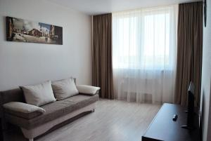 A bed or beds in a room at Apartments Malina City 2