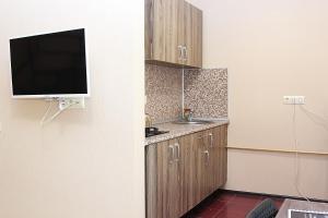 Кухня или мини-кухня в Apart-Hotel Domodedovo