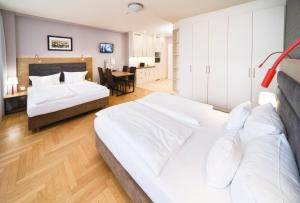A bed or beds in a room at AMC Apartments Ku'damm