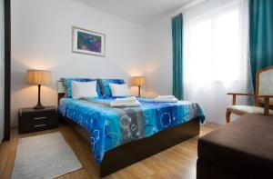 Un ou plusieurs lits dans un hébergement de l'établissement Apartment Luka