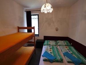 Postel nebo postele na pokoji v ubytování Apartmán Chlupáč