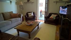 A seating area at Book Keepers Cottage