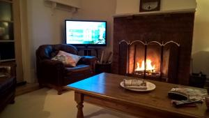 A television and/or entertainment center at Book Keepers Cottage