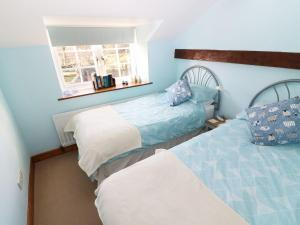 A bed or beds in a room at Dove Cote, Appleby-in-Westmorland