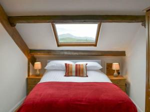 A bed or beds in a room at Emily's View, Wigton