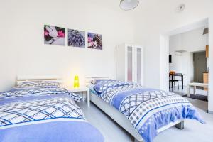 A bed or beds in a room at Apartments Mönchengladbach