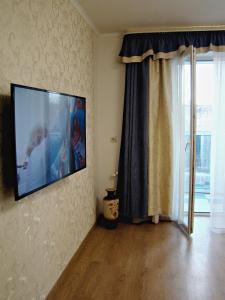 Телевизор и/или развлекательный центр в Apartment on Pestelya