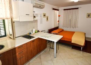 A kitchen or kitchenette at Apartments Santa Croce Rovinj
