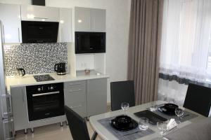 Кухня или мини-кухня в Апартаменты «Мечта 24»
