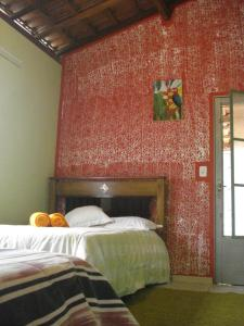A bed or beds in a room at Casa da Romilda