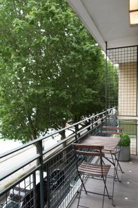 A balcony or terrace at Veeve - By the Riverbank
