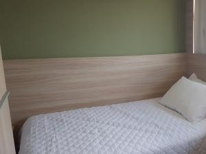 A bed or beds in a room at NOB1804 Excelente Flat em Boa Viagem com 2 quartos