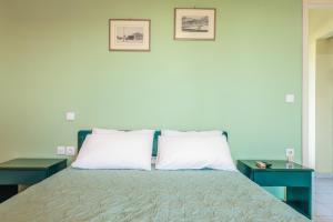 Letto o letti in una camera di Villaggio Verde