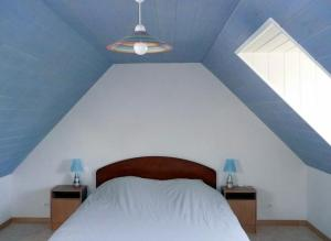 A bed or beds in a room at Holiday rental in Brittany - Finistere
