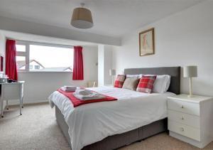 Ein Bett oder Betten in einem Zimmer der Unterkunft Puffin House
