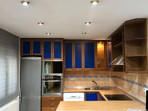 A kitchen or kitchenette at Best apartment near REAL MADRID Stadium